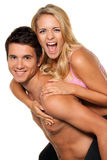 Lachend jong paar dat pret en vreugde heeft. Royalty-vrije Stock Afbeelding