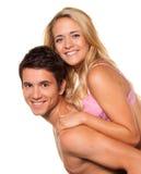 Lachend jong paar dat pret en vreugde heeft. Stock Afbeelding
