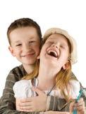 Lachend jongen en meisje Stock Fotografie