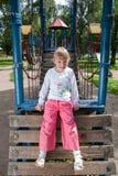 Lachend meisje op een speelplaats Royalty-vrije Stock Foto