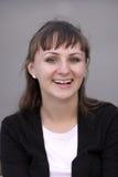 Lachend Meisje op grijze achtergrond Royalty-vrije Stock Afbeelding