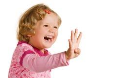 Lachend meisje in roze kleding Stock Afbeeldingen