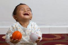 Lachende baby. Stock Foto