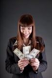 Lachende bedrijfsvrouw met dollars Royalty-vrije Stock Foto