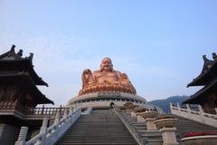 Lachende Buddha-Figürchen Stockfotos