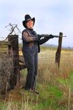 Lachende Dame Gunman Stockbilder