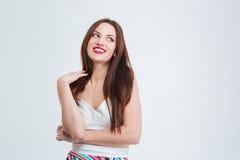 Lachende Frau, die weg schaut Stockfotografie