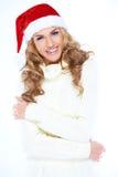 Lachende Frau in einem roten Sankt-Hut Stockfoto
