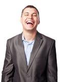 Lachende gelukkige jonge zakenman Royalty-vrije Stock Afbeelding
