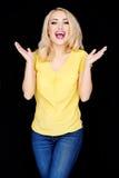 Lachende glückliche blonde Frau Stockfotografie