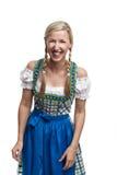 Lachende junge Frau in einem Dirndl Lizenzfreie Stockfotos