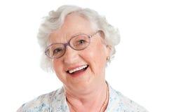 Lachende lächelnde gealterte Frau Stockfotos
