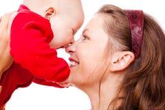 Lachende Mutter und Schätzchen Stockfotos