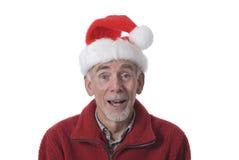 Lachende oude mens in de hoed van de Kerstman Stock Foto's