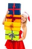 Lachende Sankt-Frau mit Weihnachtsgeschenken Lizenzfreie Stockfotos