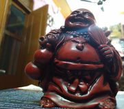 Lachender Buddha stockbilder