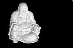 Lachender Buddha getrennt auf Schwarzem Stockbild