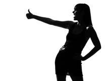 Lachender Daumen der stilvollen Schattenbildfrau oben Stockbilder
