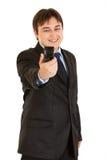 Lachender Geschäftsmann, der sich fotografiert Stockfotos