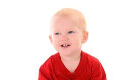 Lachender kleiner blonder Junge Stockfoto