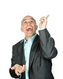 Lachender Mann, der oben zeigt lizenzfreie stockbilder