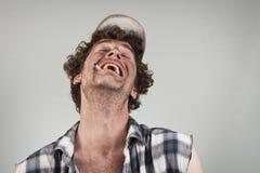 Lachender weißer reaktionärer Hinterwäldler Lizenzfreie Stockfotografie