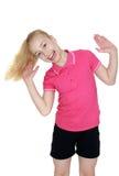 Lachendes blondes Mädchen in der roten Strickjacke und im Schwarzen Lizenzfreies Stockfoto