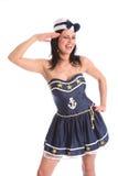 Lachendes Mädchen des reizvollen Seemannspaßes im Abendkleid Stockbild