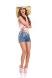 Lachendes Mädchen in Straw Hat Standing On Tiptoe Stockbilder
