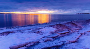 Lachine Quebec Winter. Lachine Lakeshore, January 2016. Sun setting in the horizon giving a false impression of a distant furnace that is warming the land stock images