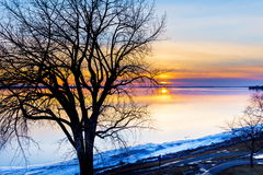 Lachine Quebec Winter. Lachine Lakeshore, January 2016. Sun setting in the horizon giving a false impression of a distant furnace that is warming the land royalty free stock photos