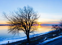 Lachine Quebec Winter. Lachine Lakeshore, January 2016. Sun setting in the horizon giving a false impression of a distant furnace that is warming the land stock photos