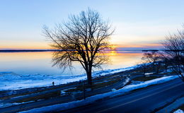 Lachine Quebec Winter. Lachine Lakeshore, January 2016. Sun setting in the horizon giving a false impression of a distant furnace that is warming the land stock photography