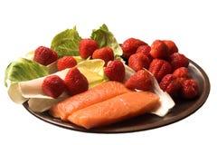 Lachse u. Erdbeeren Stockfotos