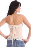 Lacing in back of fashion corset on young model Royalty Free Stock Images