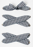 Lacing of black and white checkered ribbon Royalty Free Stock Photos
