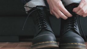 Lacing boots stock footage