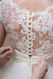 Lacing corset of wedding gown Royalty Free Stock Images