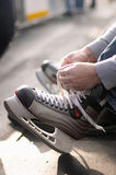 Lacing ice hockey skates Royalty Free Stock Image