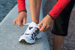 Lacing running shoes. Royalty Free Stock Photos