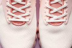 Pink women sneakers. Lacing on sneakers close-up. Pink sneakers, women sport  fashion lidestyle royalty free stock photo