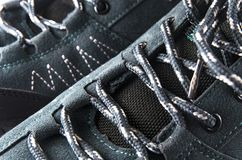 Lacing on trekking shoes. Large royalty free stock images
