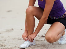 Lacing up before running Royalty Free Stock Photo