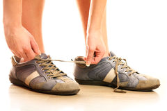 Lacing up shoes Stock Photos