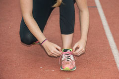 Lacing up the shoes for sprints Royalty Free Stock Photography