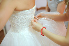 Lacing up the Wedding Dress Stock Photography