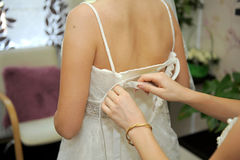 Lacing up the Wedding Dress Stock Images