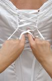 Lacing the wedding dress Royalty Free Stock Photos