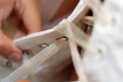 Lacing The Wedding Dress Stock Image