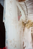 Lacing of the wedding dress Royalty Free Stock Photography